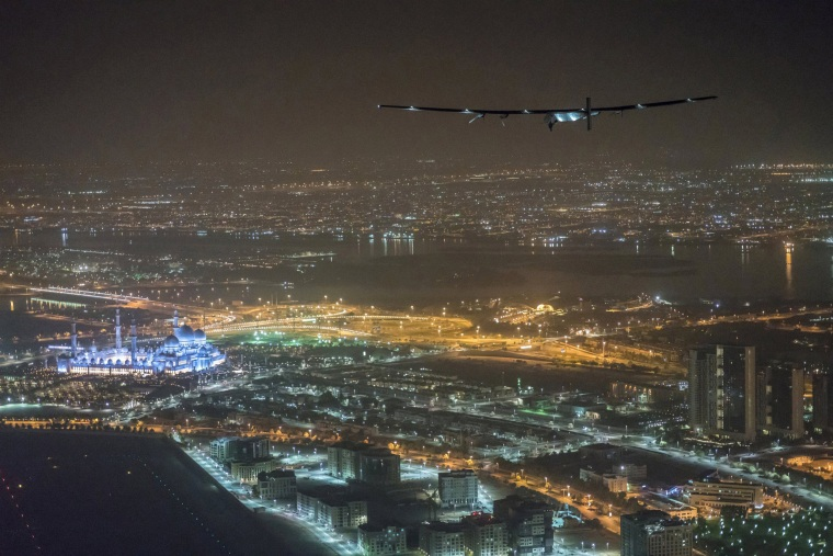 Image: Solar Impulse 2, the solar powered plane, piloted by Swiss pioneer Bertrand Piccard, is seen before landing in Abu Dhabi to finish the first around the world flight without the use of fuel