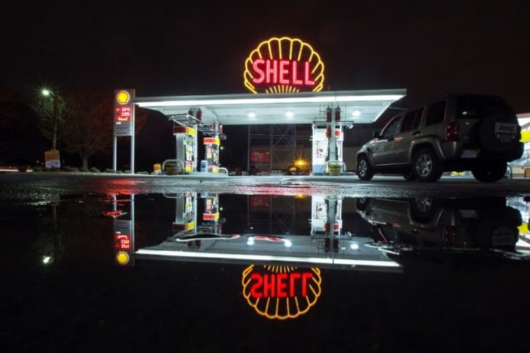 A vintage Shell sign is seen illuminated at a Shell gas station in Cambridge, Massachusetts