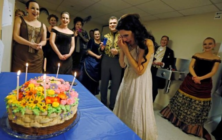 "Performer Martinez wipes away tears as she is presented with birthday cake during a break of the performance of ""Rusalka"" at the Lyric Opera in Chicago"