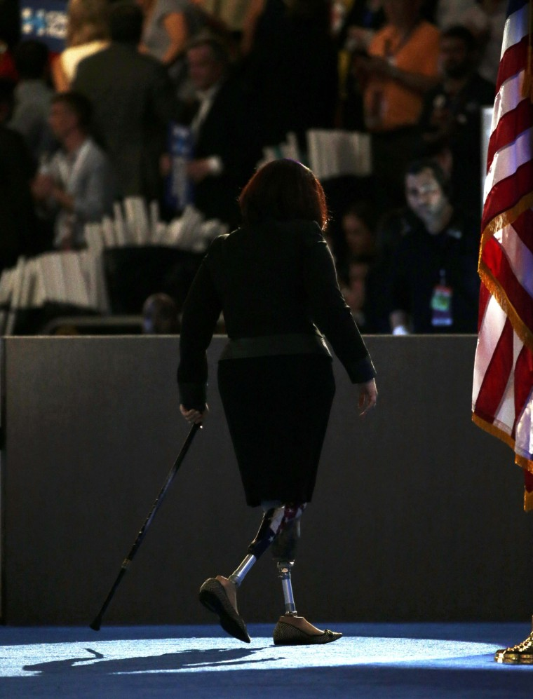 Image: Representative Tammy Duckworth (D-IL) leaves the stage at the Democratic National Convention in Philadelphia, Pennsylvania