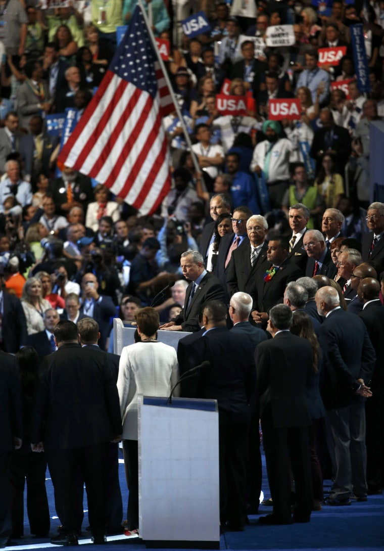 Image: Retired USMC General John Allen is joined by veterans while addressing at the Democratic National Convention in Philadelphia