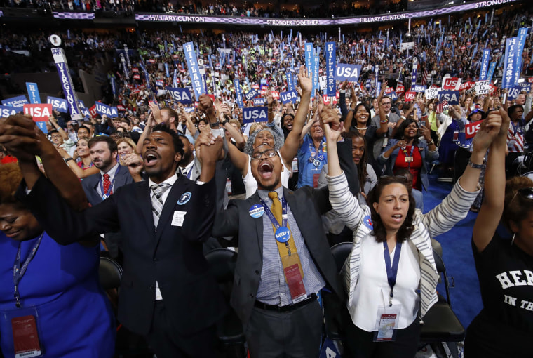 Image: Delegates sing together on the convention floor during the fourth and final night at the Democratic National Convention in Philadelphia