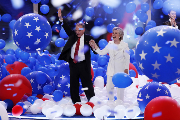 Image: Kaine and Clinton walk through balloons at the end of the DNC