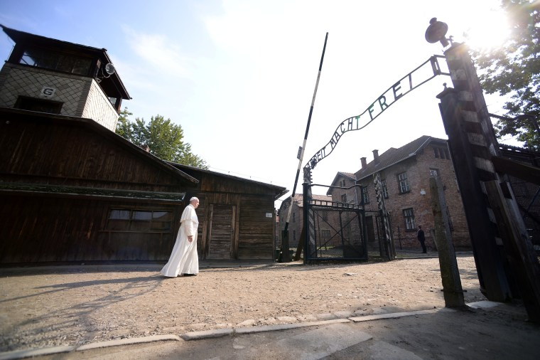 Image: Pope Francis walks through Auschwitz's notorious gate during his visit to the former Nazi death camp