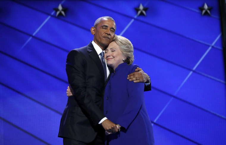 Image: Democratic presidential nominee Clinton hugs U.S. President Obama as she arrives onstage at the end of his speech on the third night of the 2016 Democratic National Convention in Philadelphia