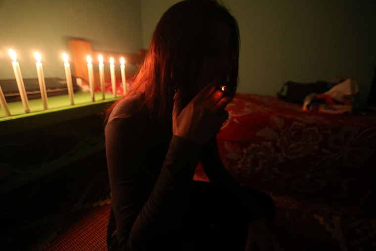 FILE PHOTO: A Syrian sex trafficking victim smokes a cigarette at her safe house
