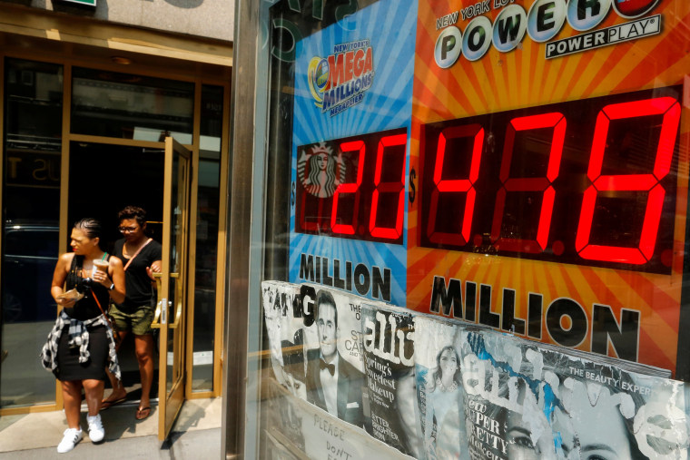Image: An electronic display shows the Powerball lottery jackpot in New York