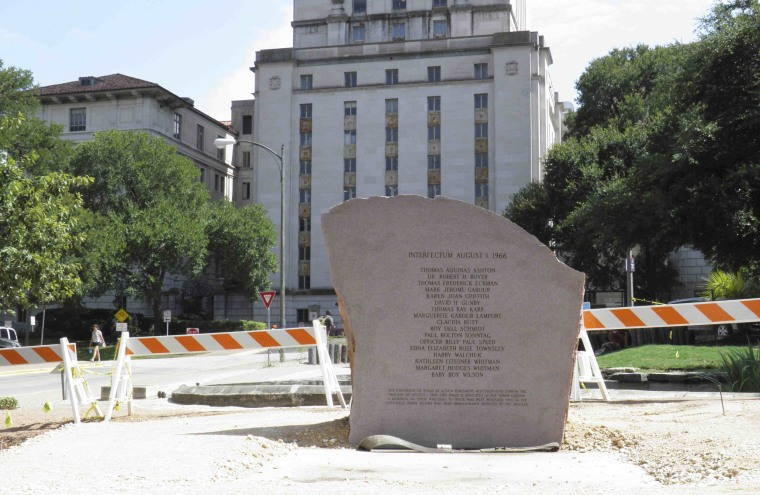 Image: A stone memorial to the 16 people and one fetus who died in the August 1, 1966 mass shooting at the University of Texas in Austin