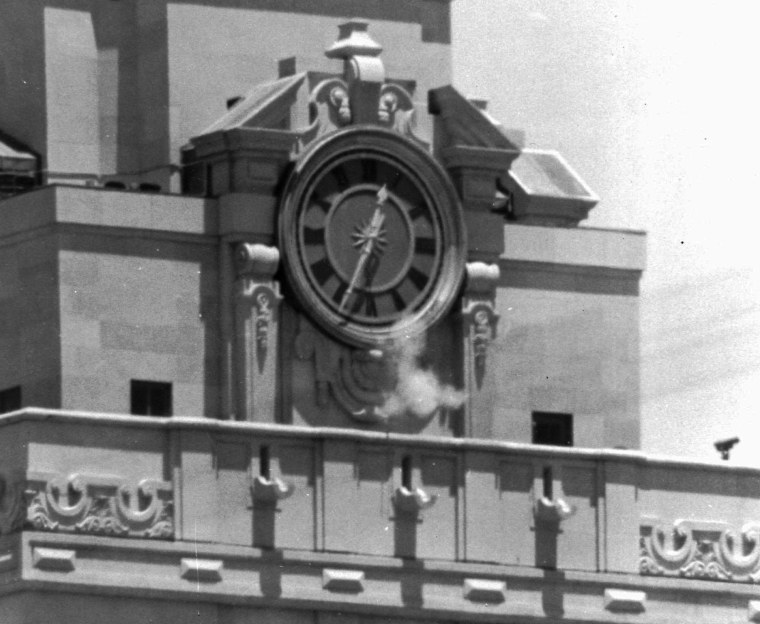 FILE: In this Aug. 1, 1966 file photo, smoke rises from the sniper's gun as he fired from the tower of the University of Texas administration building in Austin, Texas, on crowds below.