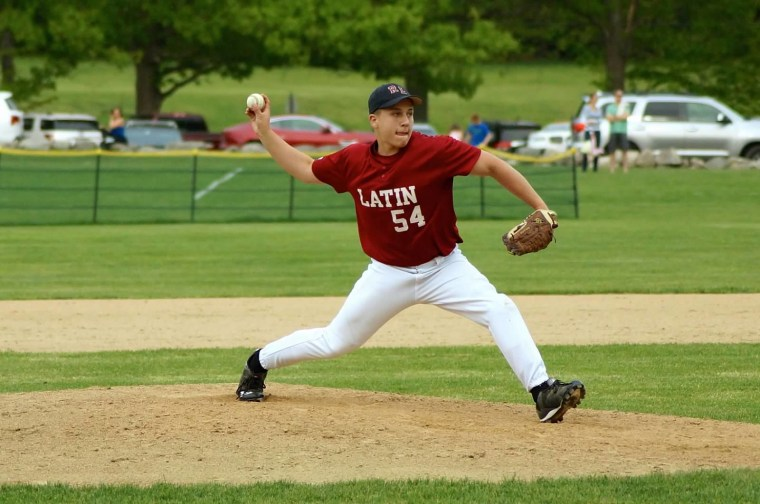 Jack, at a baseball game, was active in school sports following his leg surgery.