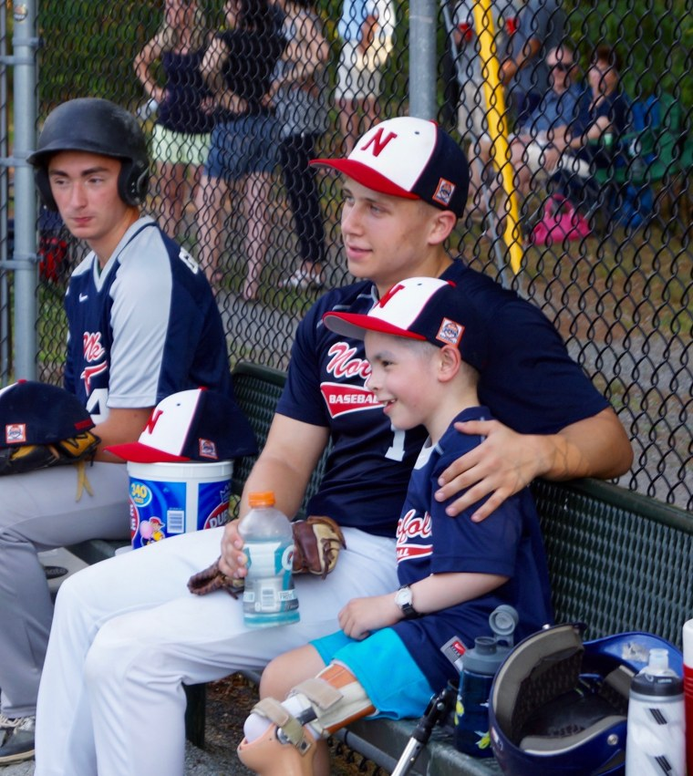 The two boys at Jack's recent game. Jack had a a special jersey made for Carter so he could be part of the team for the day.