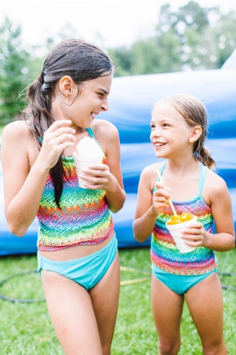 Girls eating snow cones in summer