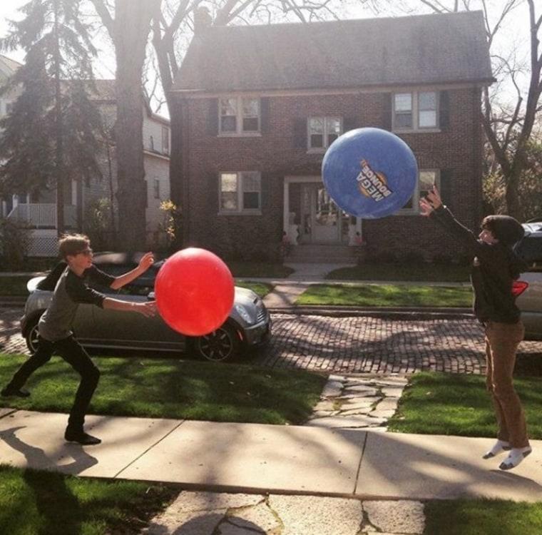 Kids bouncing a huge ball