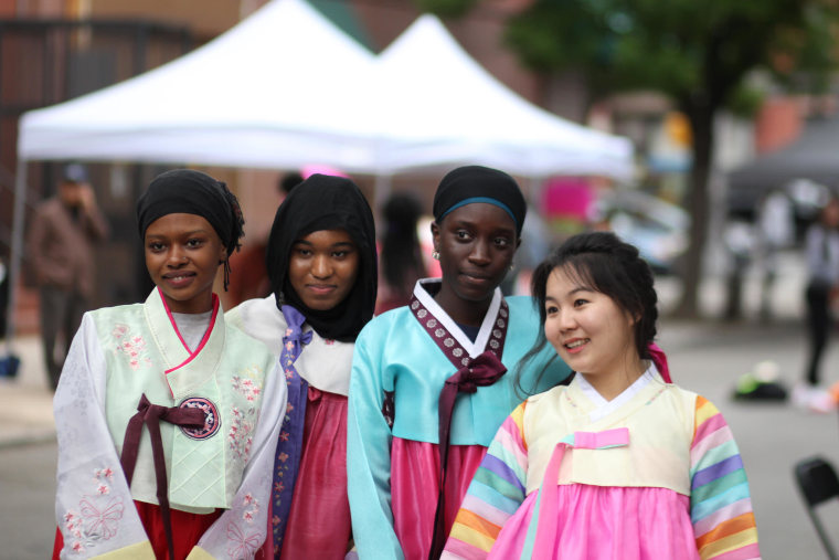 Democracy Prep students wear hanbok, or traditional Korean dresses, at the annual Korean Street Fair in New York.