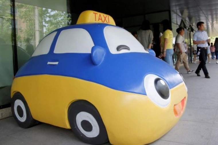 A mascot of Didi Chuxing is seen at the company's headquarters in Beijing