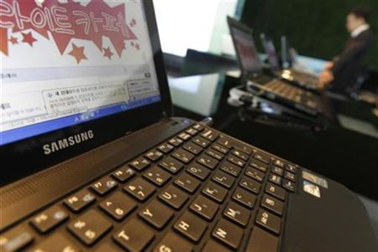 A business man uses a laptop displayed at main office of Samsung Electronics in Seoul
