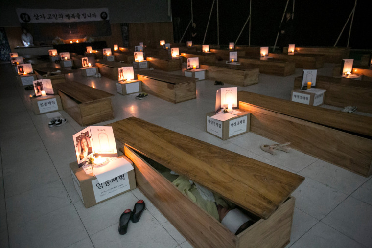 Image: *** BESTPIX *** South Koreans Reflect On Their Lives By Faking Deaths