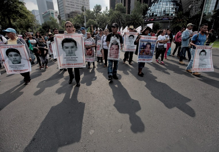 Family members of the Ayotzinapa's 43 missing students demonstrate in Mexico City