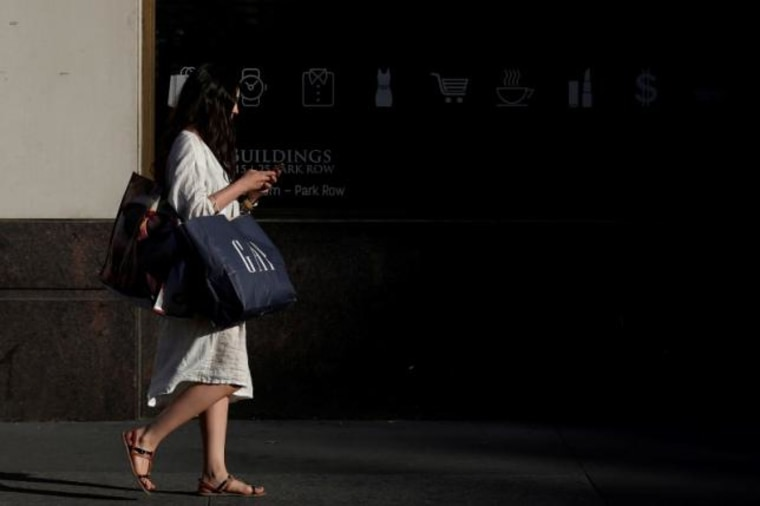 A woman carries shopping bags while walking in New York