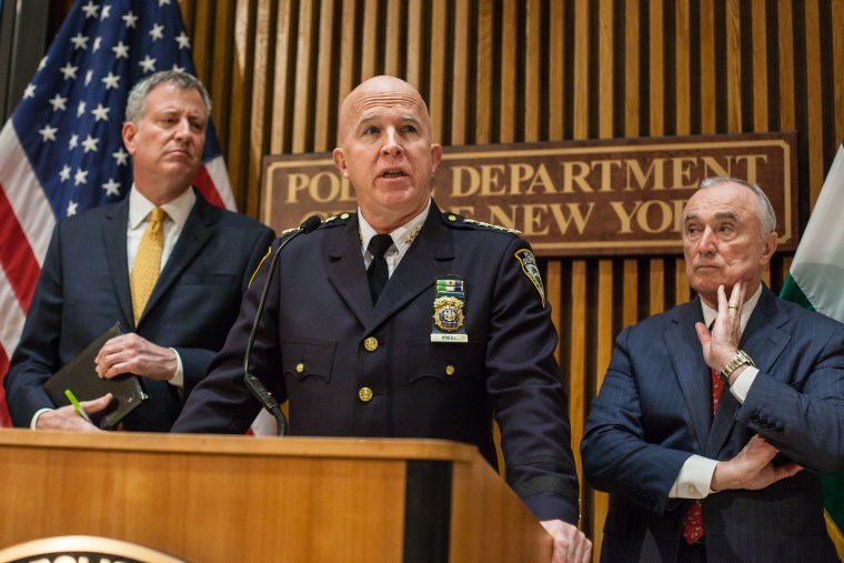 """Mayor Bill De Blasio, Chief of Department James P. """"Jimmy"""" O'Neill and Police Commissioner Bill Bratton at a Crime statistics press conference in New York, on Feb. 3, 2016."""