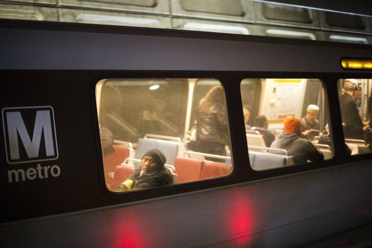 Passengers ride a Washington Metro subway train at the Chinatown Metro Station in Washington.