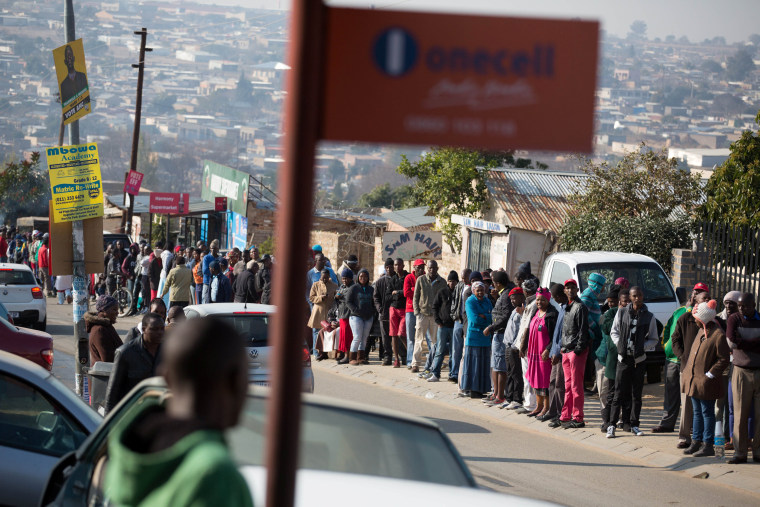 Image: Locals queue to cast their votes during the Local Government elections in Diepsloot township, north of Johannesburg, South Africa