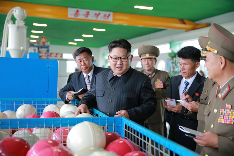 Image: Kim Jong Un visits a factory in an image released on July 30, 2016
