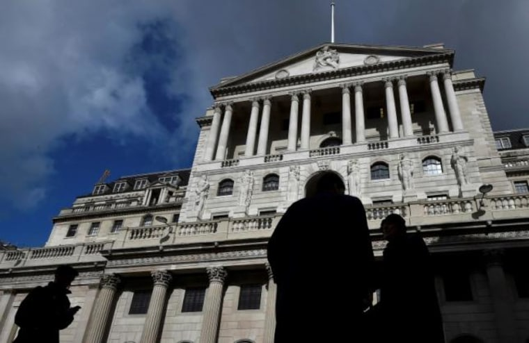 File photo of city workers walking past the Bank of England in the City of London