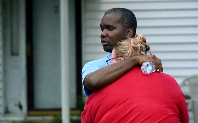 Kenneth Walker, a volunteer firefighter with the North Tonawanda, N.Y., Fire Department, embraces his wife, Amanda, at their home.