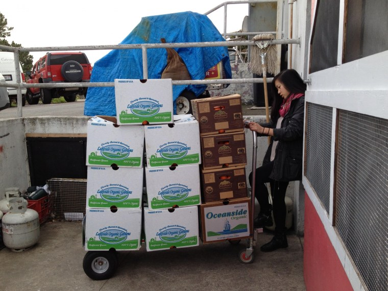 Zoe Wong, co-founder of Cerplus, during a produce delivery.