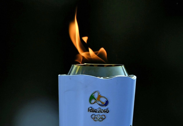 Image: TOPSHOT-OLY-2016-RIO-TORCH