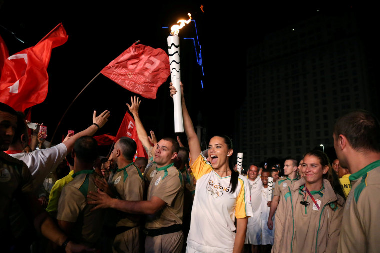 Image: Model Adriana Lima carries the Olympic torch in Maua Square in Rio de Janeiro