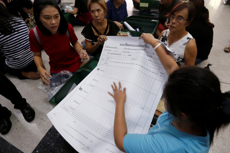Image: Election Commission volunteers check voting materials and ballot boxes a day before the referendum on a new constitution at Ratchathewi district office in Bangkok