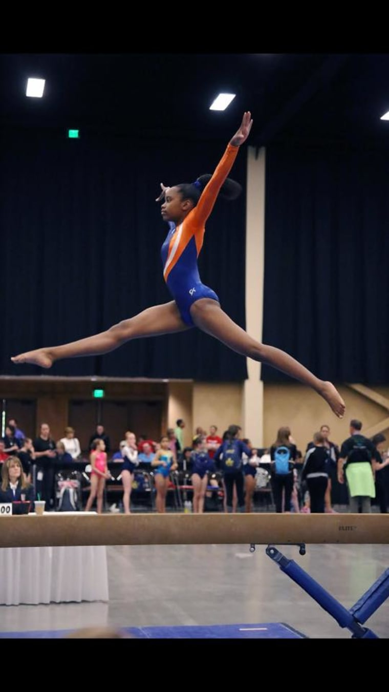 Kaiya Connor performing at the state meet in Concord, North Carolina in May 2016, where she got first place in vault.