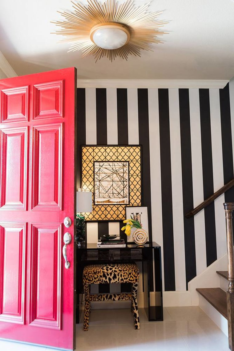 A grand red door is one way to make a showstopping entrance to a Leo's house.