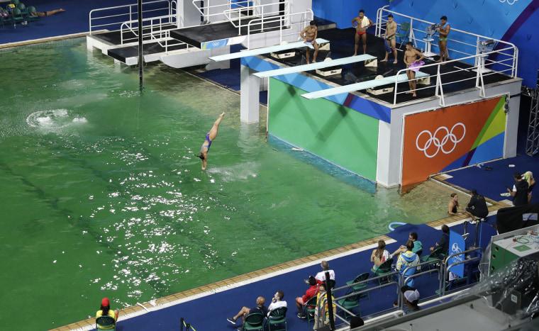 Competition continues at the diving pool, despite the mysterious color change of the water.