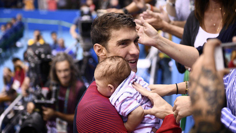 Michael Phelps holds his son Boomer