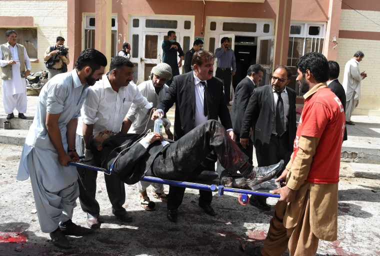 Image: Patient on stretcher after bombing at hospital in Quetta, Pakistan