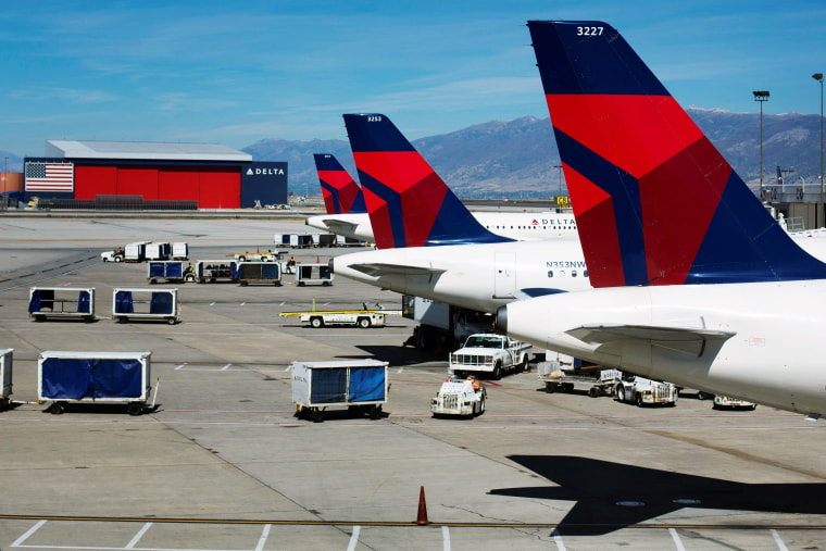 Image: Delta planes line up at their gates while on the tarmac of Salt Lake City International Airport in Utah