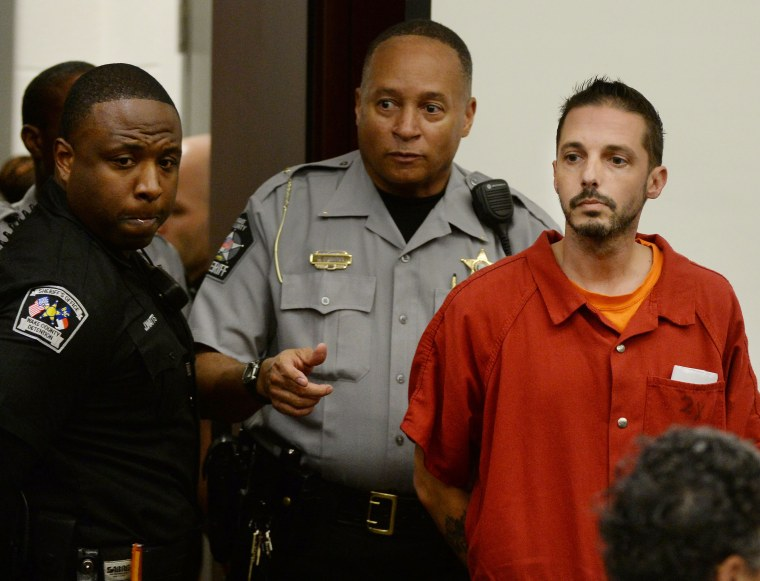 """Chad Cameron Copley, 39, is led into a courtroom at the Wake County Judicial Center in Raleigh, N.C. Monday, Aug. 8, 2016. Copley, who apparently called police to complain about """"hoodlums"""" near his house, was charged with murder after he shot and killed a black man outside, authorities said."""