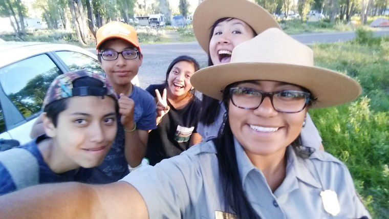 Image: Ranger Millie Jimenez poses for a selfie with Pura Vida middle school students