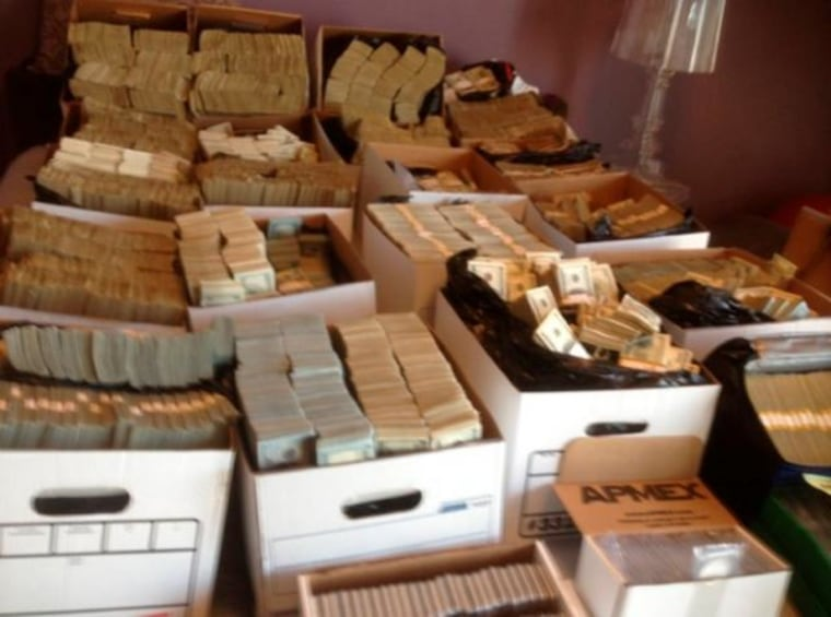Department of Justice handout photo shows boxes containing U.S. currency seized during a raid in the Los Angeles Fashion District