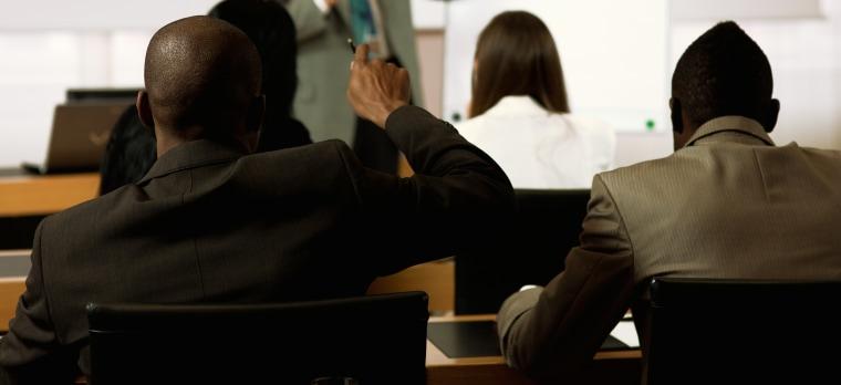 Adult student raising hand on seminar