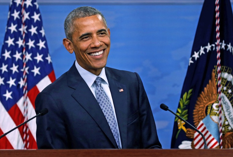 Image: Obama smiles during a news conference at the Pentagon in Arlington, Virginia, U.S.