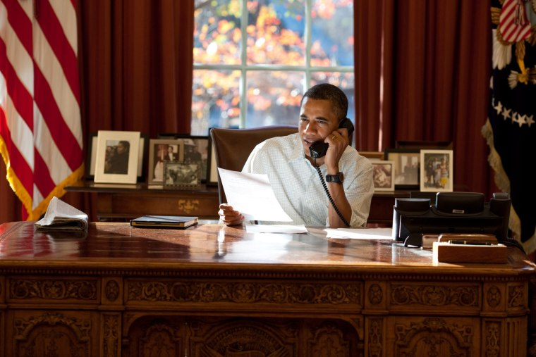 President Obama works in the Oval Office at the White House.