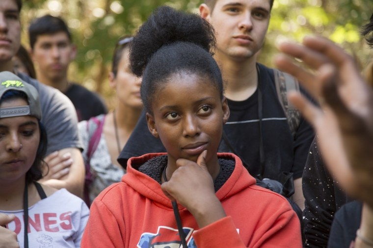Image: A student listens to Ranger Shelton Johnson welcome them into Yosemite National Park.