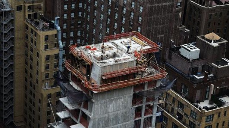 Construction laborers work on the top floor of a high rise apartment building in New York. Jewel Samad   AFP   Getty Images