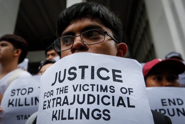 Image: Students hold candle light protest against extrajudicial killings