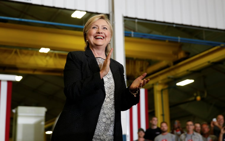 Image: U.S. Democratic presidential nominee Hillary Clinton smiles as she is introduced at Futuramic Tool & Engineering in Warren