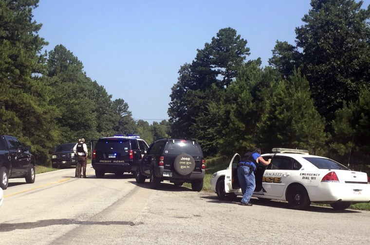Law enforcement block an intersection during a stand off after two officers where shot in Sebastian County in Western Arkansas on Wednesday, Aug. 10, 2016.